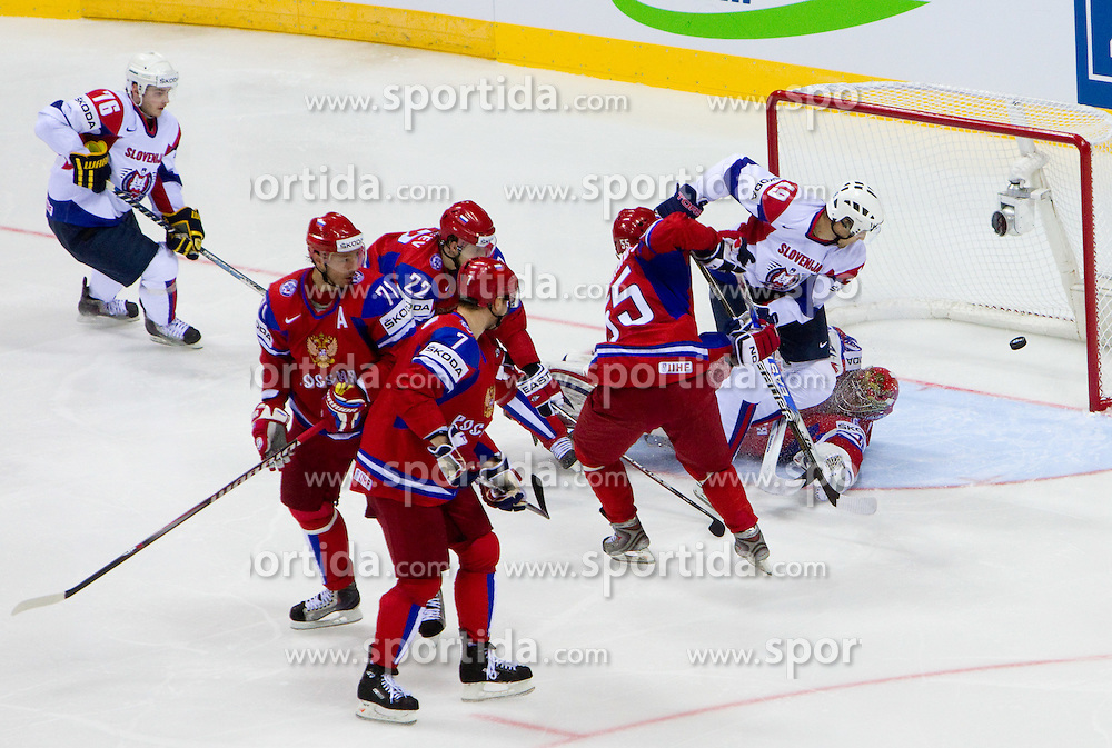 Ziga Pance of Slovenia vs Yevgeni Nabokov of Russia during ice-hockey match between Russia and Slovenia of Group A of IIHF 2011 World Championship Slovakia, on May 1, 2011 in Orange Arena, Bratislava, Slovakia. (Photo By Vid Ponikvar / Sportida.com)