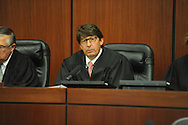 U.S. District judge Mike Mills attends a naturalization ceremony in federal court in Oxford, Miss. on Friday, June 29, 2012. Forty seven persons took the oath of citizenship.