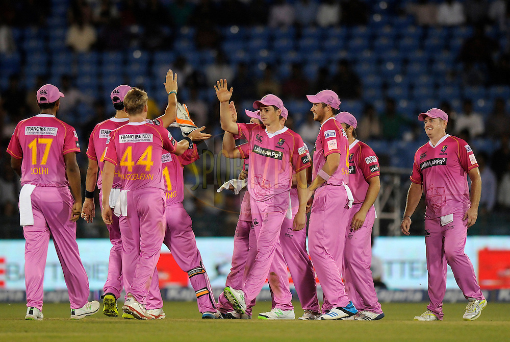 Scott Kuggeleijn of Northern Knights celebrates the wicket of Hashim Amla of Cape Cobras during match 3 of the Oppo Champions League Twenty20 between the Cape Cobras and the Northern Knights held at the Chhattisgarh International Cricket Stadium, Raipur, India on the 19th September 2014<br /> <br /> Photo by:  Pal Pillai / Sportzpics/ CLT20<br /> <br /> <br /> Image use is subject to the terms and conditions as laid out by the BCCI/ CLT20.  The terms and conditions can be downloaded here:<br /> <br /> http://sportzpics.photoshelter.com/gallery/CLT20-Image-Terms-and-Conditions-2014/G0000IfNJn535VPU/C0000QhhKadWcjYs