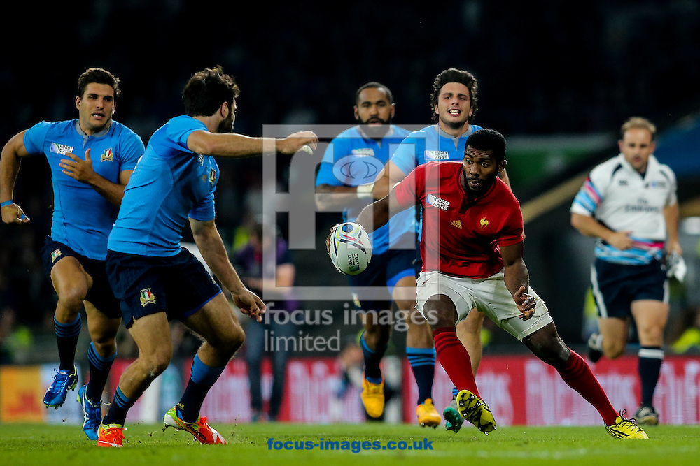 Noa Nakaitaci of France (right) attacks the Italian defence during the 2015 Rugby World Cup match at Twickenham Stadium, Twickenham<br /> Picture by Andy Kearns/Focus Images Ltd 0781 864 4264<br /> 19/09/2015