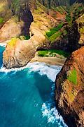 Honopu Arch and Honopu Beach on the Na Pali Coast (aerial), Napali Coast Wilderness State Park, Kauai, Hawaii USA