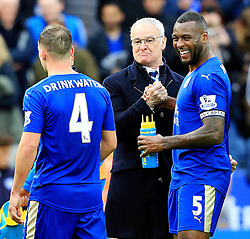 Leicester City Manager Claudio Ranieri celebrates with Wes Morgan at full time  - Mandatory by-line: Matt McNulty/JMP - 24/04/2016 - FOOTBALL - King Power Stadium - Leicester, England - Leicester City v Swansea City - Barclays Premier League