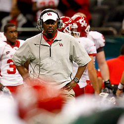 November 10, 2011; New Orleans, LA, USA; Houston Cougars head coach Kevin Sumlin watches from the sideline during the second quarter against the Tulane Green Wave at the Mercedes-Benz Superdome.  Mandatory Credit: Derick E. Hingle-US PRESSWIRE
