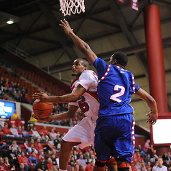 Jan 31, 2009; Piscataway, NJ, USA; Rutgers guard Corey Chandler (25) takes a shot under the block of DePaul forward Dar Tucker (2) during the second half of Rutgers' 75-56 victory over DePaul in NCAA college basketball at the Louis Brown Athletic Center