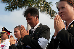 © Licensed to London News Pictures. 01/02/2013. Location, Cambodia. Mourners of  the Late former King Norodom Sihanouk  pray  during his royal funeral procession ahead of his Feb. 4, cremation Friday, Feb. 1, 2013, in Phnom Penh, Cambodia.  Photo credit : Charles Fox/LNP