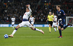 BRITAIN-LONDON-FOOTBALL-CHAPIONS LEAGUE-HOTSPUR VS EINDHOVEN.(181106) -- LONDON, Nov. 6, 2018  Tottenham Hotspur's Dele Alli (L) tries to control the ball during the UEFA Champions League match between Tottenham Hotspur and PSV Eindhoven in London, Britain on Nov. 6, 2018. Tottenham Hotspur won 2-1.  FOR EDITORIAL USE ONLY. NOT FOR SALE FOR MARKETING OR ADVERTISING CAMPAIGNS. NO USE WITH UNAUTHORIZED AUDIO, VIDEO, DATA, FIXTURE LISTS, CLUBLEAGUE LOGOS OR ''LIVE'' SERVICES. ONLINE IN-MATCH USE LIMITED TO 45 IMAGES, NO VIDEO EMULATION. NO USE IN BETTING, GAMES OR SINGLE CLUBLEAGUEPLAYER PUBLICATIONS. (Credit Image: © Xinhua via ZUMA Wire)