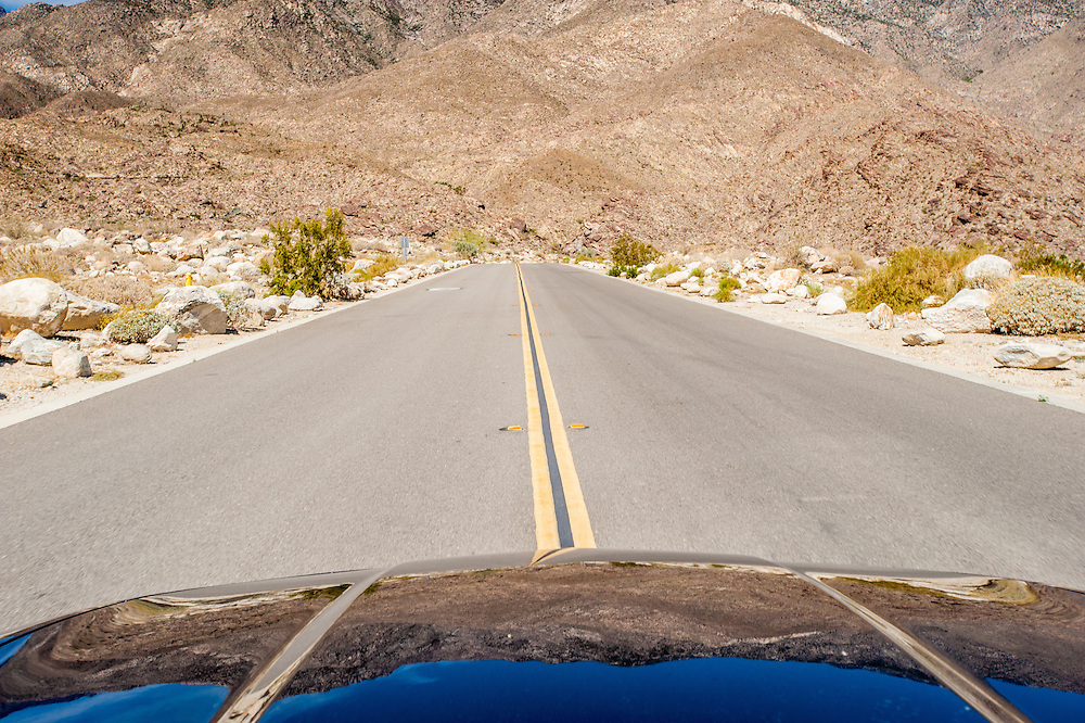 Front of car and middle of a road near Palm Springs, California