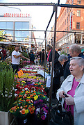 Shoppers hunt for bargains and beauty among the many colourful flower bouquets available at the daily market at Hötorget in central Stockholm, Sweden