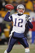 PITTSBURGH - JANUARY 23:  Quarterback Tom Brady #12 of the New England Patriots unloads a pass against the Pittsburgh Steelers during the AFC Championship game at Heinz Field on January 23, 2005 in Pittsburgh, Pennsylvania. The Pats defeated the Steelers 41-27. ©Paul Anthony Spinelli  *** Local Caption *** Tom Brady