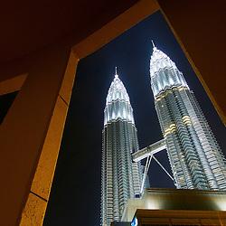 The world's tallest twin towers, Petronas Towers dominate the skyline of Kuala Lumpur, Malaysia.