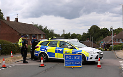 Tunbridge Wells Kent, Tuesday 17th JULY 2018, Tunbridge Wells, Street remains on lockdown with officers guarding each end of the cordon after a serious stabbing. Shocked neighbours described seeing and hearing the air ambulance land in a nearby Temple Grove Academy just before 12pm. Officers can still be seen along with paramedics from South East Coast. <br /> <br /> The area remains on lock down  showing the scene as Sherwood road sealed off following the stabbing in broad daylight.  Police have closed the road in Tunbridge Wells, Sherwood Road. Road is currently closed in both directions between Greggs Wood Road and Conneyburrow Road due to a Police incident. <br /> <br /> Expect delays in the area Scene of crime officers can be seen enter either 67or 69 Sherwood Road  which is understood to be a flat.  &copy;UKNIP
