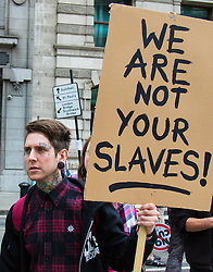 """London, June 20th 2015. Thousands of people converge on the streets of London to join the People's Assembly Against Austerity's march from the Bank of England to Parliament Square. PICTURED:  A woman sends her message """"We are not your slaves"""" to the City's wealthy bankers. //Contact for image Licencing: Paul@pauldaveycreative.co.uk Tel:07966016296"""