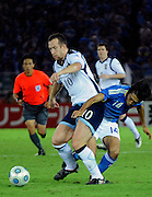 Scotland's Charles Adam forces his way past Kengo Nakamura of Japan  during their friendly match against Japan in Yokohama, Japan on Saturday 10 Oct. 2009. Japan won 2-0..Photographer: Robert Gilhooly
