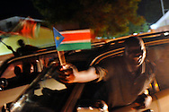 Just before midnight on the eve of independence, Southern Sudanese begin celebrating in the streets of the capital city..Juba, South Sudan. 08/07/2011..Photo © J.B. Russell