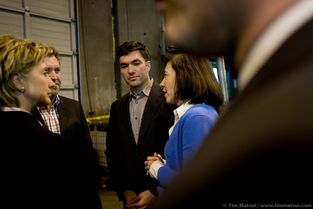 "SEATTLE, WA - Friday, January 27, 2006 U.S. Senator Hillary Clinton (D-NY) and U.S. Senator Maria Cantwell (D-WA) talk with John Plaza and Martin Tobias, president and CEO respectively, at Seattle Biodiesel where they stopped to promote energy independence and call for a greater federal support for ground-brakening alternative energy initiatives already underway at the local level. Cantwell is signing on to Clinton's legislation to create a latter-day ""Manhattan Project"" aimed at accelerating the development of advanced energy technologies.  The two senators, with democratic leader Harry Reid (D-NV) are sponsoring the Advanced Research Projects Energy (ARPA-E) Act to fund alternative energy research. Cantwell states that reliance on foreign oil is a threat to the U.S. economy, competitiveness, and national security and she supports development of non-petroleum based fuels and energy sources. Seattle Biodiesel is working with Cantwell and Washington Governor Gregoire to help develop a market for biodiesel and recently signed a fuel contract with the Port of Seattle. Negotiations are currently underway for Seattle Biodiesel to expand its operations to create the nation's largest biodiesel refinery and to do so on Port property. Clinton is also in the Pacific Northwest to support her fellow democrats at fundraisers and to solidify her support. (Photo by Tim Matsui/WpN)"
