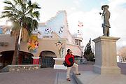 Artist David Flores of Puro Borde and his murals of his favorite Mexican actor, singer and comedian Tin Tan at Mercado Juarez next to an statue of Tin Tan in Ciudad Juarez, Mexico. .http://puroborde.org