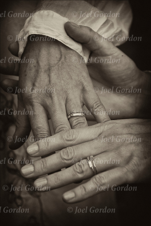 Close up of hands and wedding rings of Leigh and Helena at their Sacred Union Commitment Marriage Celebration