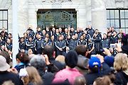 The New Zealand All Blacks, the 2011 Rugby World Cup champions parade through the streets of Wellington. Rain and strong wind wasn't enough to deter Wellington locals from welcoming their heroes.