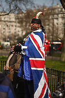 A man dressed in a Union Jack speaks to the crowd at Speaker's Corner in Hyde Park, London, England.