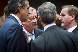 From left: Antonis Samaras, Greece's prime minister, Jean-Claude Juncker, Luxembourg's prime minister, and Enda Kenny, Ireland's prime minister, speak together, during the first day of the EU Summit, at the European Council headquarters in Brussels, Belgium on Thursday, Dec. 13, 2012. (Photo © Jock Fistick)