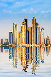 Skyline view with reflections  of many skyscrapers in Marina district of Dubai United Arab Emirates