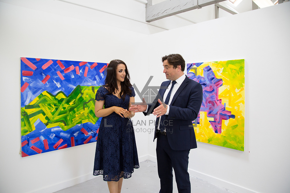 11.06.2017         <br /> International award winning artists are among the almost 200 graduates of Limerick School of Art and Design who's work went on exhibition at the LSAD Graduate Show 2017.<br /> <br /> Pictured is 4th year graduating Painting  student, Vicky Enright discussing her work titled 'Industrial Spectrum' with John Concannon, Director of Creative Ireland who officially opened the show.<br />  <br /> Students from the college took control of the over-riding message of this historical show as they conceptualised, designed and delivered on the theme - be.cause.<br />  <br /> The hypothesis conceived by Graphic Design graduates Cassandra Walsh and David Reilly, is derived from the fact the graduates have now reached a stage where they are confident with their work, their interpretations and creative solutions. As creative minds they have an innate need to &ldquo;do&rdquo; something. There is just this need to create, be.cause.<br /> . Picture: Alan Place.