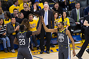 Golden State Warriors forward Kevin Durant (35) and Golden State Warriors forward Draymond Green (23) celebrate a basket against the San Antonio Spurs during Game 2 of the Western Conference Quarterfinals at Oracle Arena in Oakland, Calif., on April 16, 2018. (Stan Olszewski/Special to S.F. Examiner)