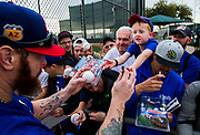 Texas Rangers first baseman Josh Hamilton (32) takes a baseball and a pen from Cooper Cook, 7, of Colorado Springs, Colorado as fans as for autographs during a spring training workout at the team's training facility on Friday, February 17, 2017 in Surprise, Arizona. (Ashley Landis/The Dallas Morning News)