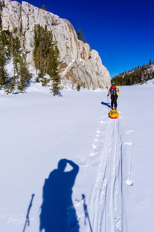 Backcountry skier crossing Mack Lake, John Muir Wilderness, Sierra Nevada Mountains, California  USA