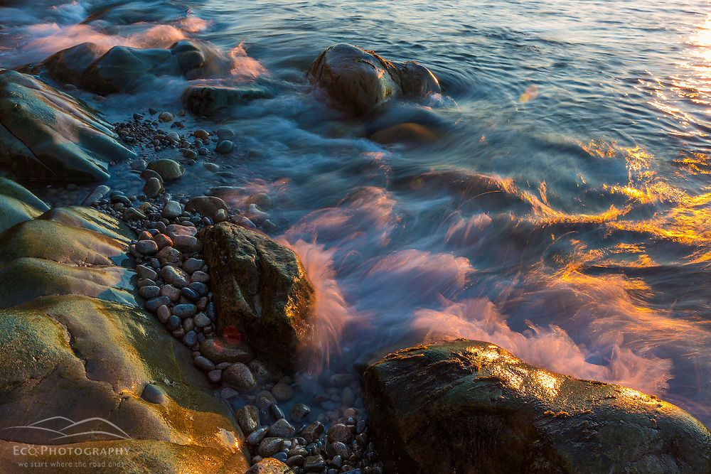 Morning sun lights the waves on the Schoodic Peninsula in Maine's Acadia National Park.