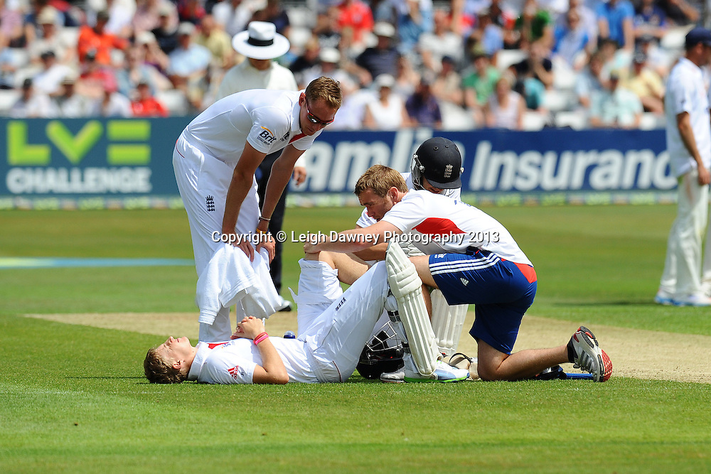 Joe Root of England get treated for an injury during England v Essex first day of a four day Ashes warm up game at the Essex County Cricket Ground, 30.06.13.  Credit: © Leigh Dawney Photography. Self Billing where applicable. Tel: 07812 790920