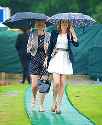 LIVERPOOL, ENGLAND - Friday, June 22, 2012: Ladies brave the torrential rain as they arrive for day two of the Medicash Liverpool International Tennis Tournament at Calderstones Park. (Pic by David Rawcliffe/Propaganda)