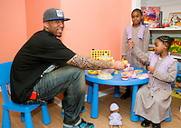 New York Knicks basketball player Wilson Chandler hosts a tea party at a Garden of Dreams Foundation event in Harlem.