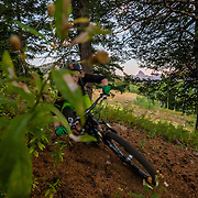Andrew Whiteford rides the lift accessed singletrack trails of Grand Targhee Resort at sunset in summer.