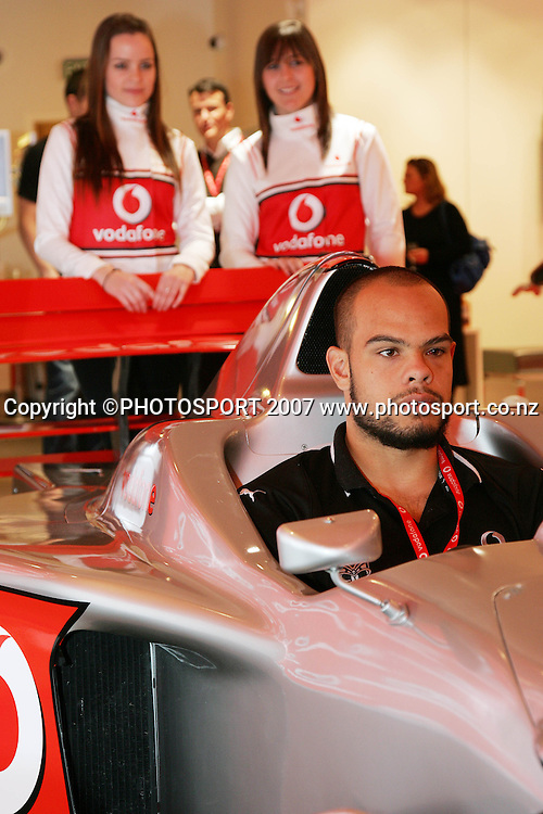 Sam Rapira drives the F1 simulator. Vodafone Warriors McLaren Mercedes F1 Simulator event. Vodafone New Zealand, Auckland. Thursday 23 August 2007. Photo: Hagen Hopkins/PHOTOSPORT