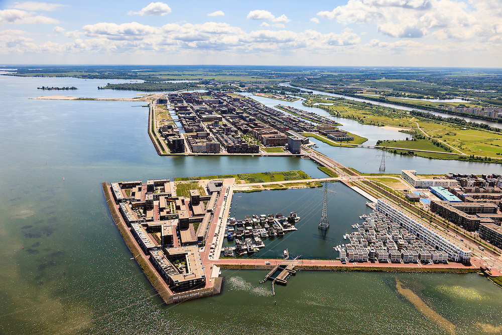 Nederland, Noord-Holland, Amsterdam, 14-06-2012; IJburg, Steigereiland, IJburglaan en zicht op het Haveneiland.New constructed urban development, residential district IJburg , floating houses..luchtfoto (toeslag), aerial photo (additional fee required).foto/photo Siebe Swart