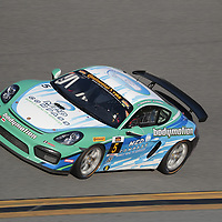 January 06, 2018 - Daytona Beach, Florida, USA:  The Bodymotion Racing Porsche Cayman GT4 races through the turns at the Roar Before The Rolex 24 at Daytona International Speedway in Daytona Beach, Florida.