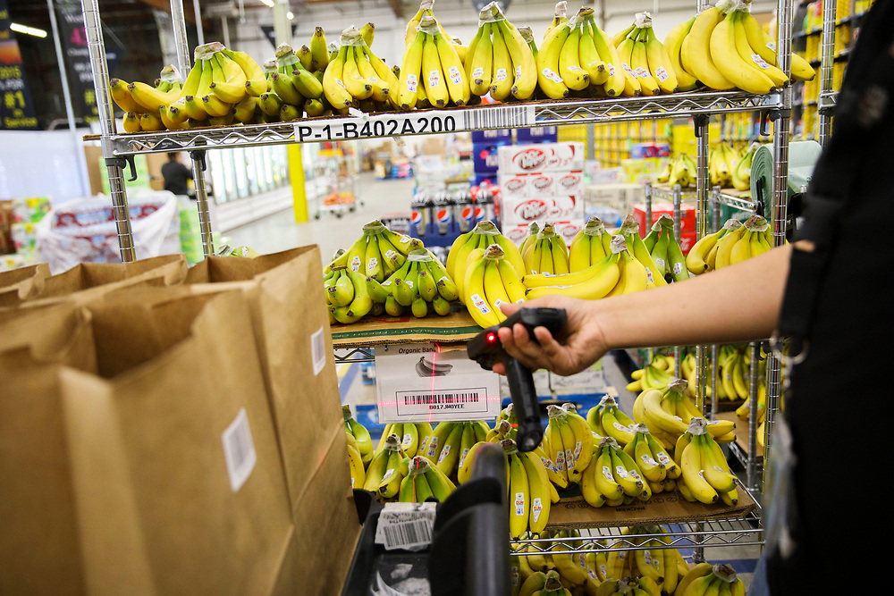 An Amazon associate scans bananas at the Amazon.com Inc. Prime Now fulfillment center warehouse on Monday, March 27, 2017 in Los Angeles, Calif. The warehouse can fulfill one and two hour delivery to customers. Complex supply chains such as Amazon's and e-commerce trends will impact city infrastructure and how things move through cities. © 2017 Patrick T. Fallon
