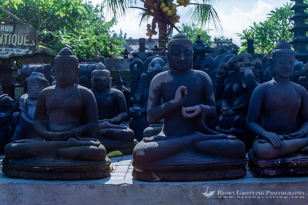Bali, Gianyar, Batubulan. Stonecarvings, Buddha figures. Batubulan is a Balinese center for stonecarving.