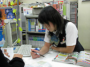 young Japanese girl working at the front desk at a travel agency Japan