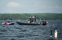 Marine Patrol Supervisor Brian Starck patrols through a no-wake zone between Eagle Island and Governors Island on Lake Winnipesaukee Thursday afternoon.  (Karen Bobotas/for the Laconia Daily Sun)