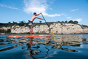Jack Haworth paddles a Pelican SUP on Newport's Back Bay