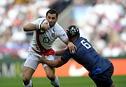 Riki Flutey is tackled by Thierry Dusautoir during the RBS Six Nations match between England and France at Twickenham Stadium, 15th March 2009.