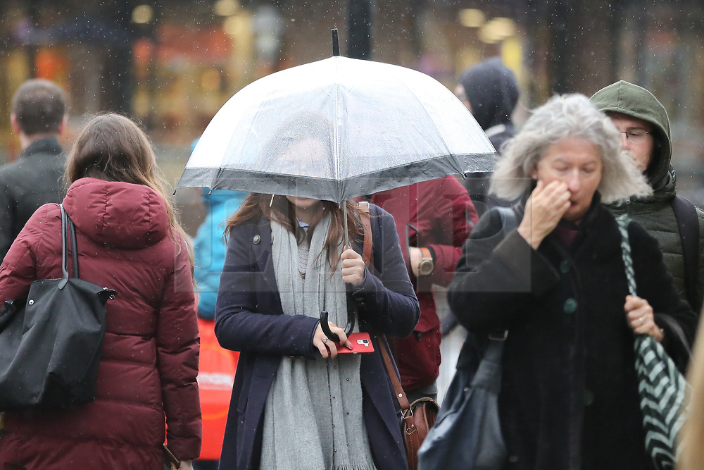 © Licensed to London News Pictures. 03/03/2019. London, UK. A woman shelter from the rain beneath an umbrella during heavy downpour in north London.  Photo credit: Dinendra Haria/LNP
