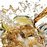 Bacardi and Coke splashing onto ice and lime Ray Massey is an established, award winning, UK professional  photographer, shooting creative advertising and editorial images from his stunning studio in a converted church in Camden Town, London NW1. Ray Massey specialises in drinks and liquids, still life and hands, product, gymnastics, special effects (sfx) and location photography. He is particularly known for dynamic high speed action shots of pours, bubbles, splashes and explosions in beers, champagnes, sodas, cocktails and beverages of all descriptions, as well as perfumes, paint, ink, water – even ice! Ray Massey works throughout the world with advertising agencies, designers, design groups, PR companies and directly with clients. He regularly manages the entire creative process, including post-production composition, manipulation and retouching, working with his team of retouchers to produce final images ready for publication.