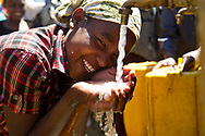 A girl enjoys fresh water, in Ethiopia for Water Aid.