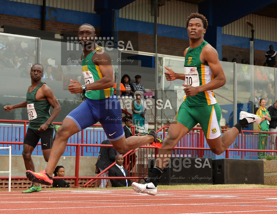 DURBAN, SOUTH AFRICA - JUNE 22: Johs Swaray of Senegal and Gift Leotlela of South Africa in the heats of mens 100m during the morning session on day 1 of the CAA 20th African Senior Championships at Kings Park Athletic stadium on June 22, 2016 in Durban, South Africa. (Photo by Roger Sedres/Gallo Images)
