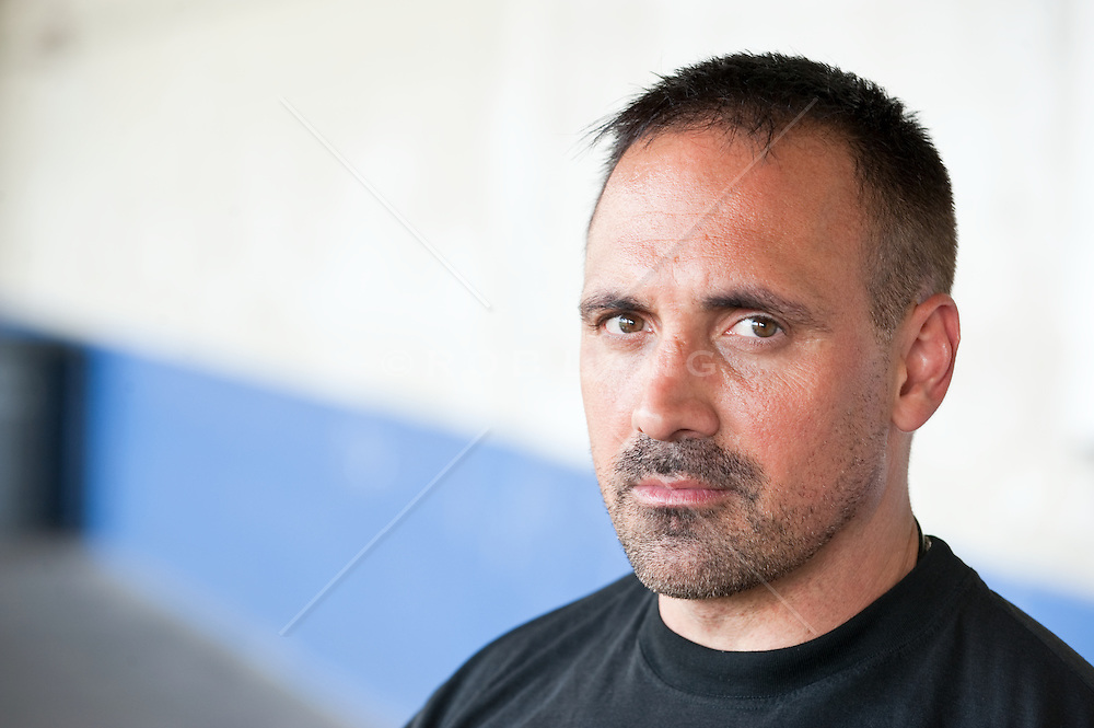 Portrait of an Italian American man with a serious expression on his face