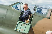 John Romain, Pilot and Chief Engineer at the Aircraft Restoration Company - Vickers Supermarine Spitfire Mk.1A – P9374/G-MK1A – it was in action in the Battle of France in 1940 and recovered from the sands of a Calais beach in 1980. It was restored by the Aircraft Restoration Company, and will fly in the VE Day Anniversary Air Show (Saturday 23 and Sunday 24 May) at IWM Duxford. Christie's is to offer the Spitfire P9374 for auction in The Exceptional Sale on 9 July 2015.  The estimate for the sale is  £1,500,000-2,500,000. With the plane are John Romain, Pilot and Chief Engineer at the Aircraft Restoration Company and Ken Wilkinson, a veteran who flew Spitfires in the Second World War. IWM Duxford, Cambridge