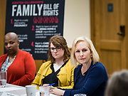 """24 MAY 2019 - WEST DES MOINES, IOWA: US Senator KIRSTEN GILLIBRAND (D-NY), right, chairs a community forum in the West Des Moines Public Library. Gillibrand unveiled her """"Family Bill of Rights"""" during a forum in West Des Moines. The New York Senator has made family health and rights a centerpiece of her campaign. She is touring Iowa this week to support her candidacy to be the Democratic nominee for the US Presidency. Iowa traditionally hosts the the first selection event of the presidential election cycle. The Iowa Caucuses will be on Feb. 3, 2020.           PHOTO BY JACK KURTZ"""